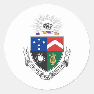 Escudo de armas del delta del Tau del delta Etiqueta
