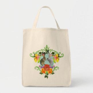 Escudo de conejos y de flores bolsas de mano