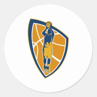 Escudo de la bola del tiro en suspensión del jugad etiqueta