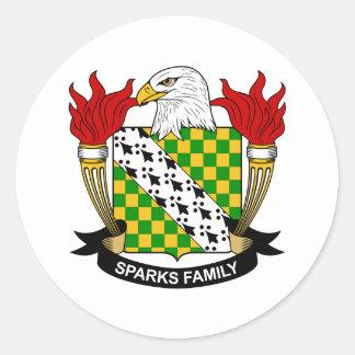Escudo de la familia de las chispas pegatina redonda