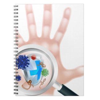 Escudo de mano de la lupa del virus de las libros de apuntes