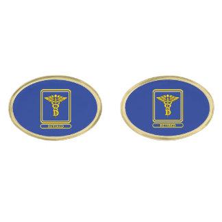 Escudo del caduceo del dentista jubilado gemelos dorados