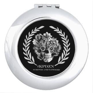 Escudo floral del cráneo espejo para el bolso