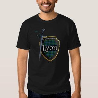 Escudo y espada escoceses del tartán de Lyon del Poleras