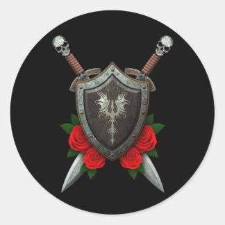 Escudo y espadas adornados gastados del dragón con pegatina