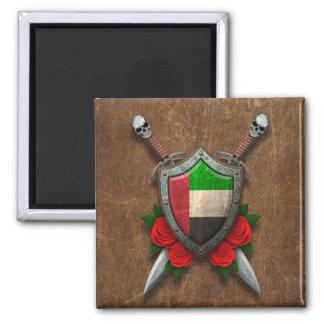 Escudo y espadas envejecidos de la bandera de Unit Iman
