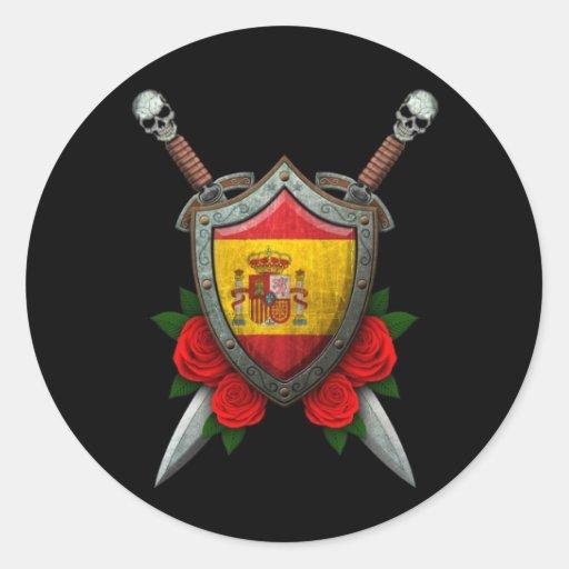 Escudo y espadas españoles gastados de la bandera  etiqueta