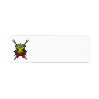 Escudo y espadas jamaicanos gastados de la bandera etiquetas de remite