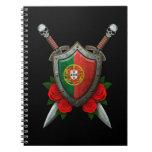 Escudo y espadas portugueses gastados de la bander libros de apuntes con espiral