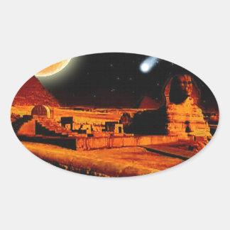 Esfinge y luna sobre el regalo del arte de las pegatina ovalada