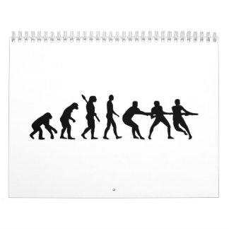 Esfuerzo supremo de la evolución calendarios de pared