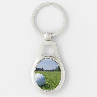 Espacio abierto del golf llavero plateado ovalado