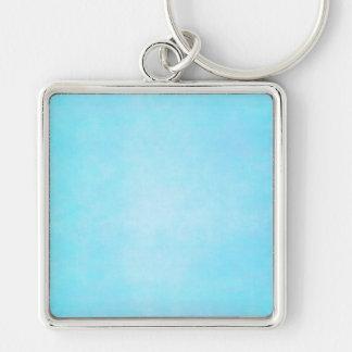 Espacio en blanco ligero azul de la plantilla de l llaveros