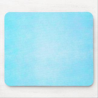 Espacio en blanco ligero azul de la plantilla de l tapetes de ratón