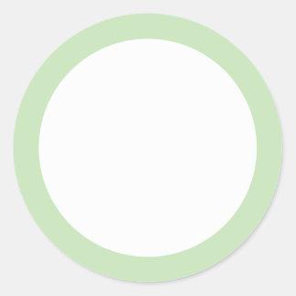 Espacio en blanco verde claro de la frontera del pegatina redonda