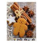 Especias del navidad, jengibre y estrellas del postales