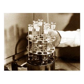 Especímenes en tubos de ensayo vidrio-tapados postales