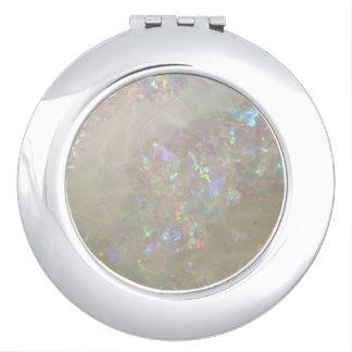 espejo compacto de la opalescencia