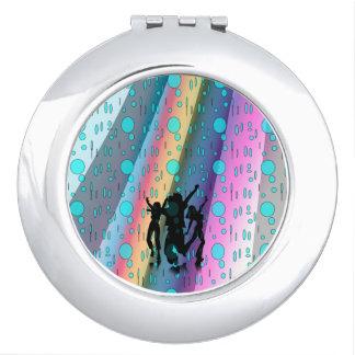 Espejo compacto redondo, danza en el diseño de la