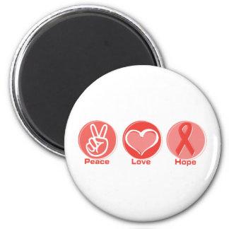 Esperanza roja de la cinta del amor de la paz imán redondo 5 cm