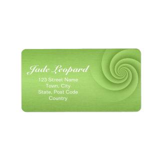 Espiral de la verde lima en textura cepillada del  etiqueta de dirección