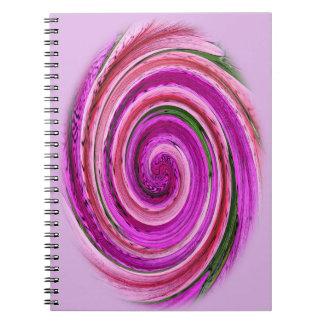 Espiral rosado en el cuaderno espiral