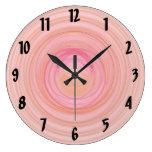 Espirales del rosa y del melocotón relojes de pared