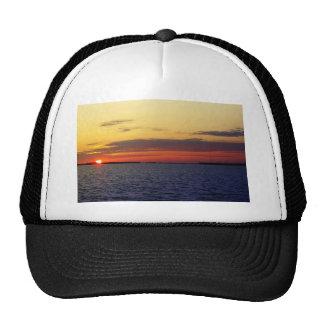 esplendor de la puesta del sol gorras