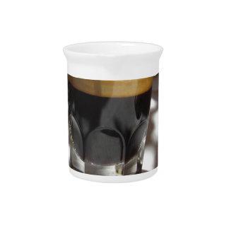 Espresso coffee with rum, sugar and lemon rind beverage pitcher