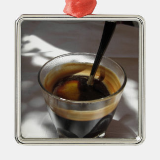 Espresso coffee with rum, sugar and lemon rind metal ornament