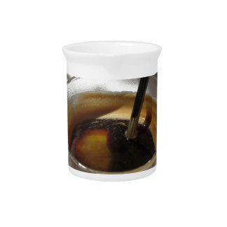 Espresso coffee with rum, sugar and lemon rind pitcher
