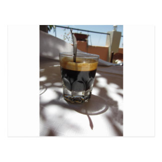 Espresso coffee with rum, sugar and lemon rind postcard