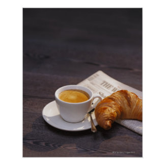 espresso, croissant and newspaper print