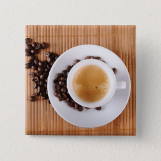 Espresso cup on a mat button