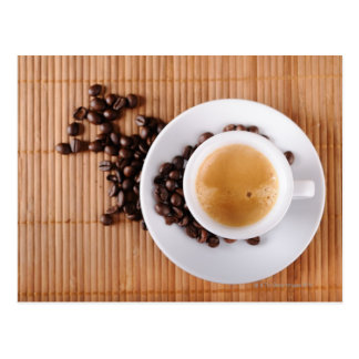 Espresso cup on a mat postcard