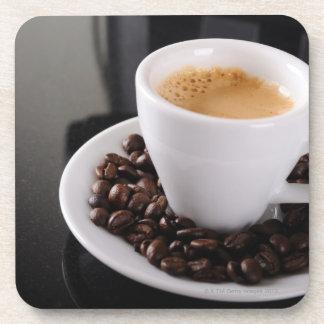 Espresso cup on black granite counter beverage coaster