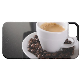 Espresso cup on black granite counter iPhone 5 covers