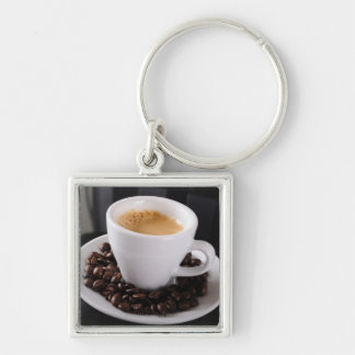 Espresso cup on black granite counter keychain