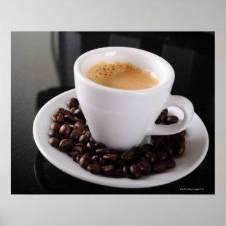 Espresso cup on black granite counter posters