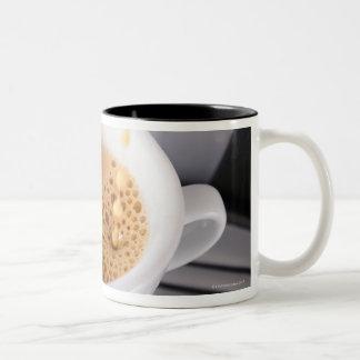Espresso pouring into cup