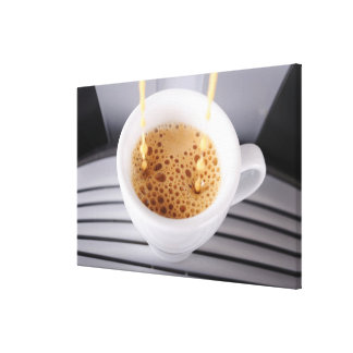 Espresso pouring into cup canvas print