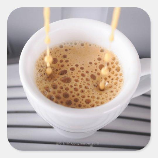Espresso pouring into cup square sticker