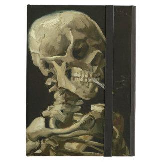 Esqueleto con la caja 1886 del aire del iPad del