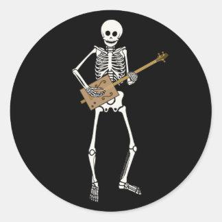 Esqueleto de la guitarra de la caja de cigarros etiqueta redonda