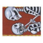 esqueletos de dia de los muertos en postal del amo