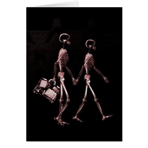 Esqueletos de la radiografía de los pares que viaj tarjeta pequeña