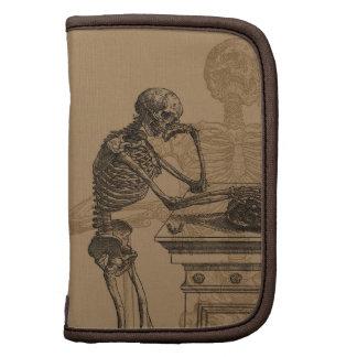 Esqueletos y folio del carrito de la muerte de la planificador