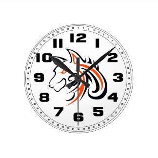 Esquema anaranjado y negro de la cabeza del lobo reloj redondo mediano