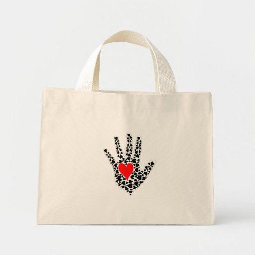 Esquema rojo y negro de la mano de los corazones bolsa lienzo