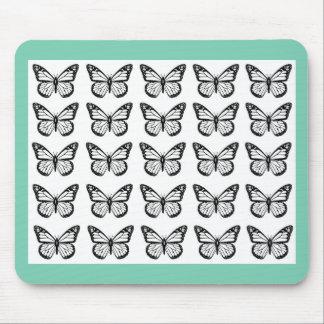 Esquemas negros de la mariposa en blanco alfombrilla de ratón